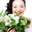 Young woman with white flowers — Stock Photo