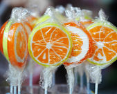 Orange lollipops — Stockfoto
