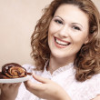 Laughing woman with cake — Stock Photo
