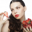 Stock Photo: Brunette lady with strawberry