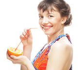 Woman sipping orange juice with a straw — Stock Photo