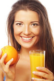 Woman holding orange and juice — Stock Photo