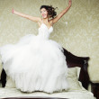 Happy bride jump on bed. — Stock Photo #29704015
