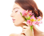 Beautiful woman with pink flowers — Stock Photo