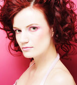 Woman with beautiful make-up and red curly hair — Stock Photo