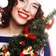Santa woman holding tree — Stock Photo