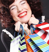 Young woman carrying shopping bags — Stock Photo
