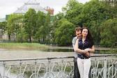 Couple walking on bridge in park — Stock Photo