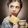 Womwith coffee and cookies — Stock Photo #29846429