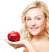 Woman with an apple ahainst white background — Stock Photo
