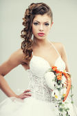 The bride with a wedding bouquet — Stock Photo