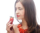 Sexy lady holding a juicy strawberry — Stock Photo