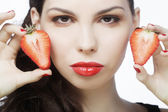 Brunette lady with strawberry — Stock Photo