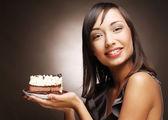 Woman holding cake — Stock Photo