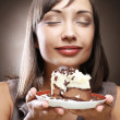Young woman with a cake — Stock Photo