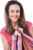Woman happy holding shopping bags. — Stock Photo