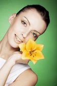 Beautiful girl with yellow flower — Stock Photo