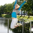 Stock Photo: Sporty woman jump outdoor