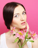 Brunette woman with flowers — Stock Photo