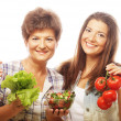 Two women  with salad and vegetables — Stock Photo