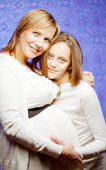 Pregnant woman with daughter — Stock Photo