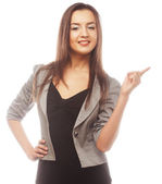 Happy business woman pointing an idea — Stock Photo