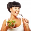 Young funny woman eating salad — Stock Photo