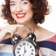 Beautiful woman with the clock — Stock Photo #30560025