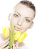 Woman with yellow tulips bouquet — Stock Photo