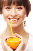 Woman drinking juice with straw — Stock Photo