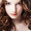 Beautiful young woman with curly hair. — Stock Photo