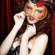 Young woman in a red mysterious mask — Stock Photo