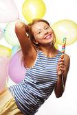 Happy girl with balloons — Stock Photo