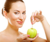 Young lady with green apple — Stock Photo
