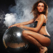 Girl in smoke with disco ball — Stock Photo