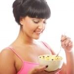 Smiling woman eating muesli — Stock Photo