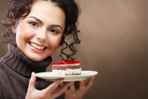 Young woman with a cake — Stock fotografie