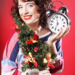 Woman holding clock and the tree — Stock Photo