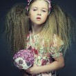Little lady with bouquet — Stock Photo