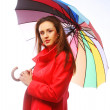 Woman in red coat with umbrella — Stock Photo #30840311