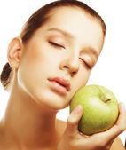 Head shot of woman holding apple — Stock Photo
