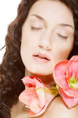 Woman and pink orchid — Stock Photo