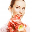 Beautiful woman with gorgeous pink flower — Stock Photo #31067743