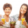 Two women with juice and salad — Stock Photo