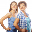 Mother and adult daughter looking up — Stock Photo #31067901