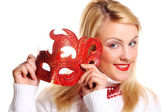 Blond girl with red mask — Stock Photo