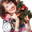 Woman holding clock and the tree — Stock Photo #31140333