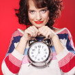 Beautiful woman with the clock — Stock Photo #31140373