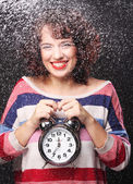 Beautiful woman with the clock — Stock Photo