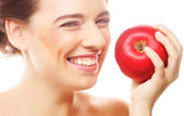 Brunette woman with red apple — Stock Photo